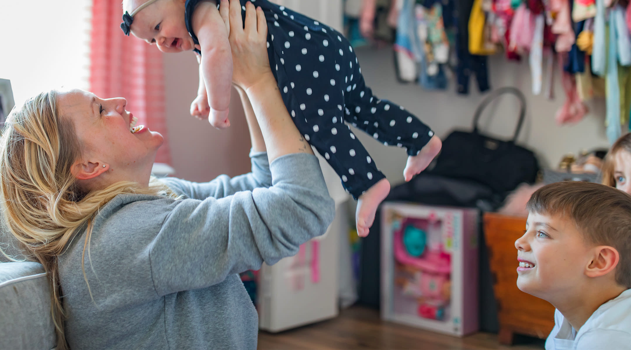 happy family with new baby in the nursery