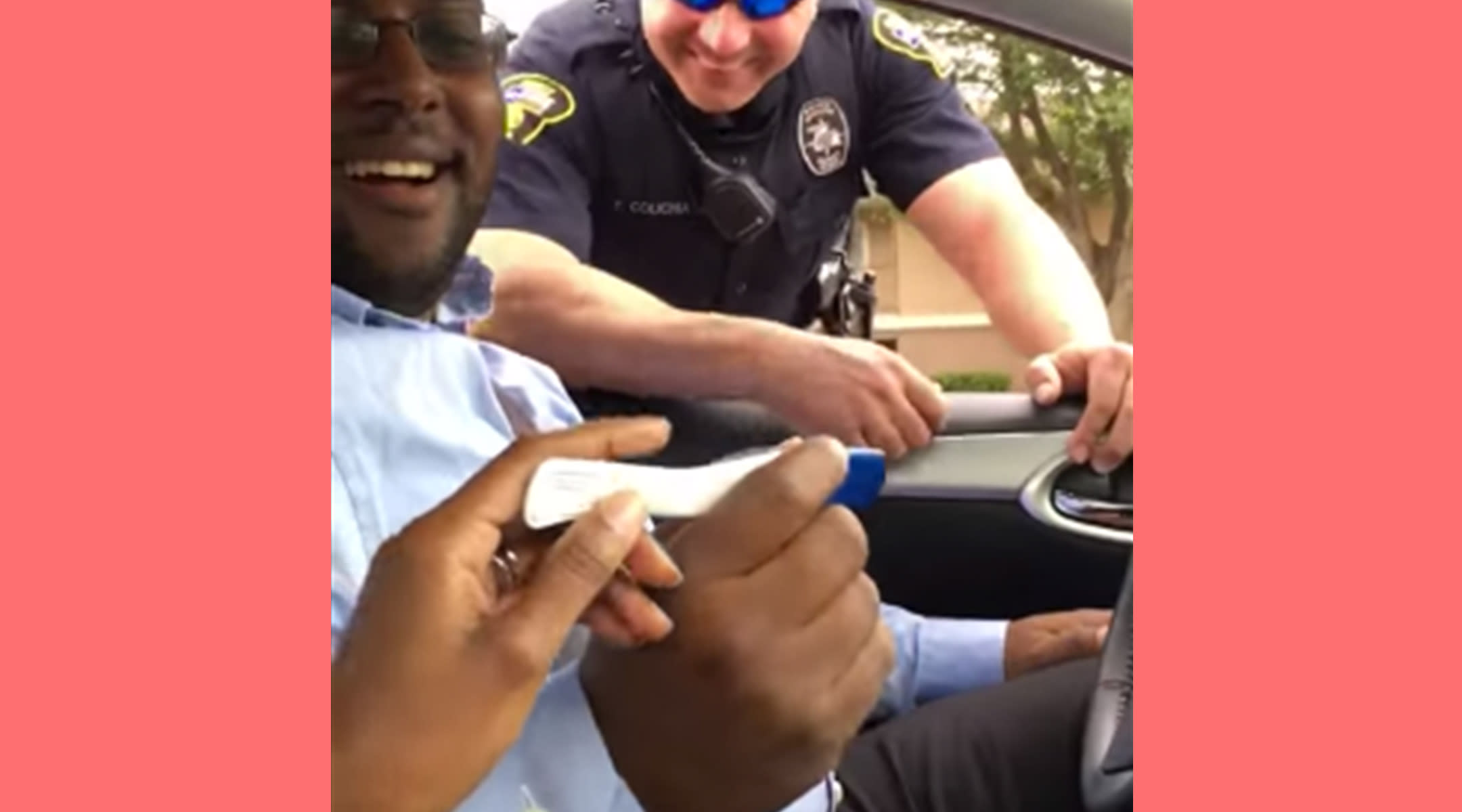 Man behind the wheel looking at a positive pregnancy test after being pulled over.