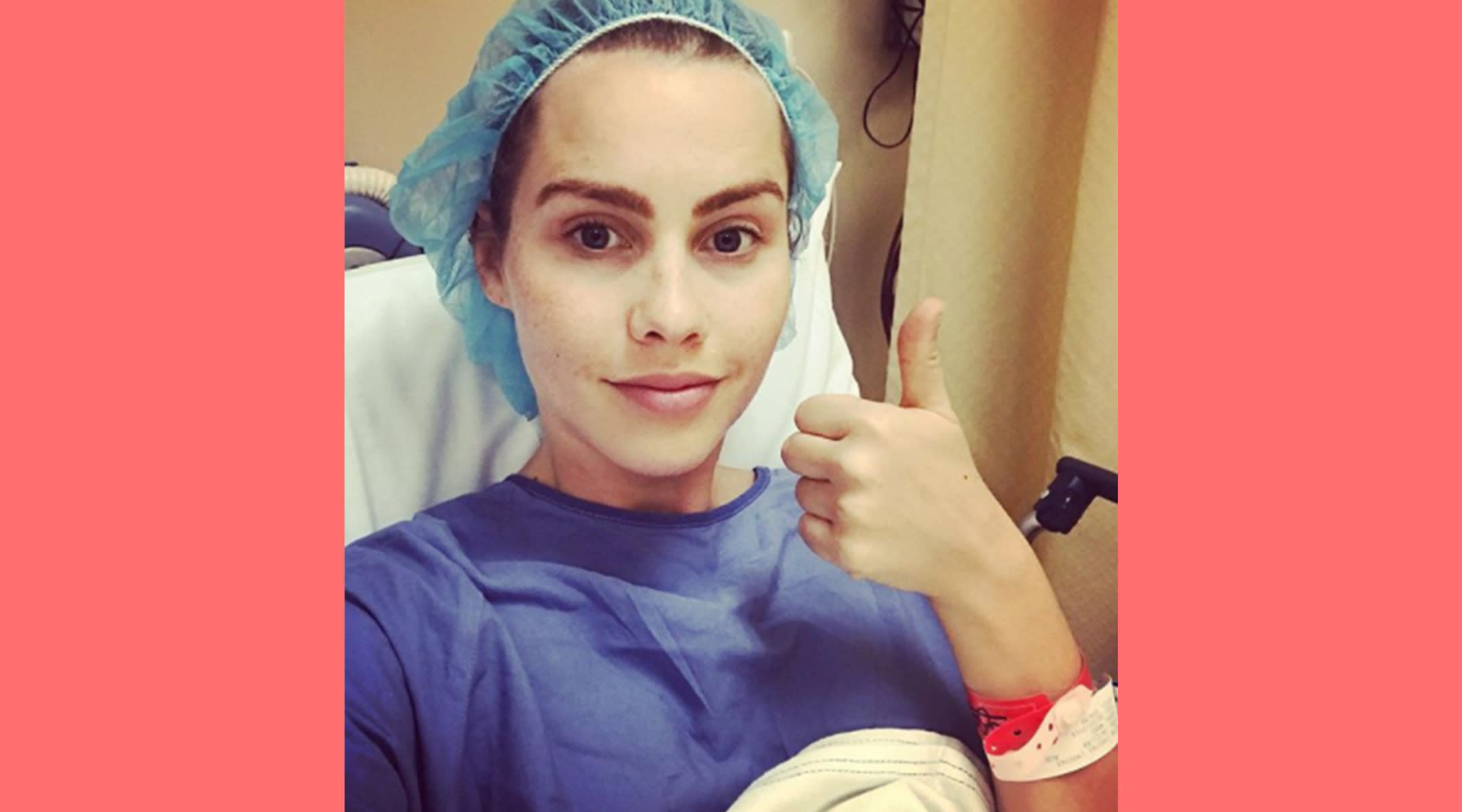 Claire Holt in hospital garb giving thumbs up