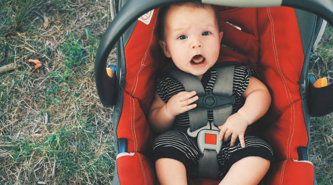 baby sitting in car seat