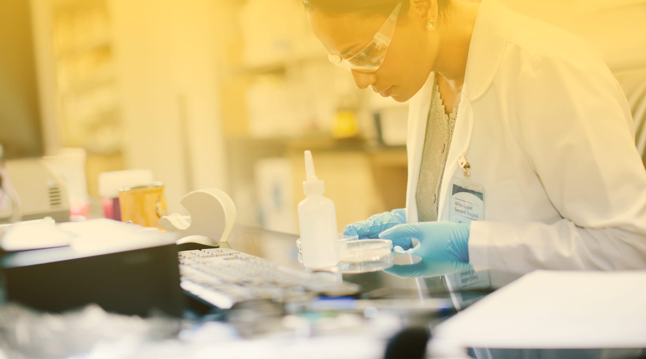 medical researcher performing tests in a lab