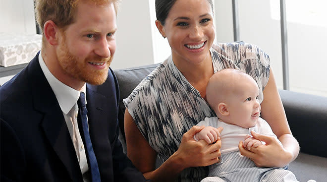 Meghan Markle and Prince Harry sitting with baby Archie.