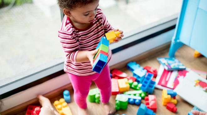 little girl playing with blocks at pre-school