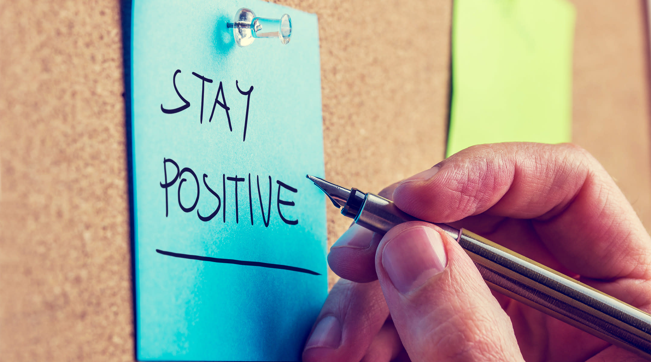 post it note that says stay positive