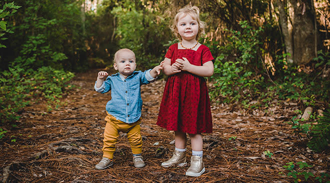 toddler sibling with baby brother dressed nicely