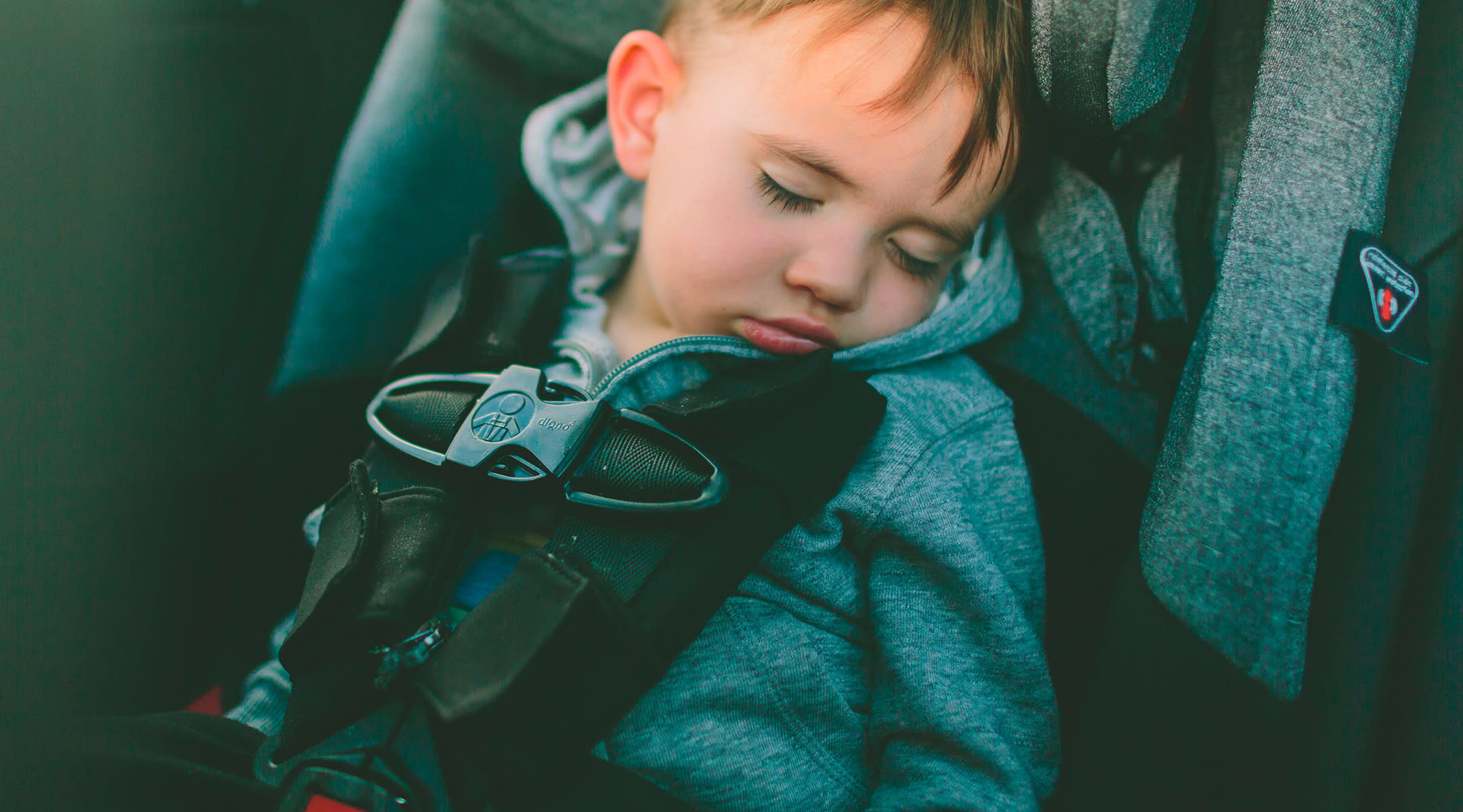 Toddler Boy Asleep In Car Seat