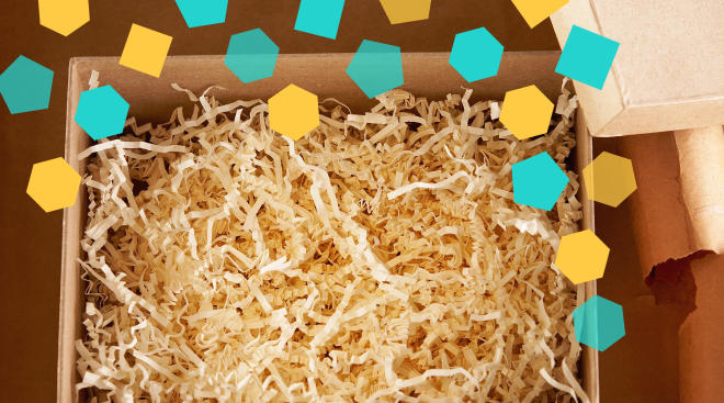 opened box with filling and collaged confetti surrounding it