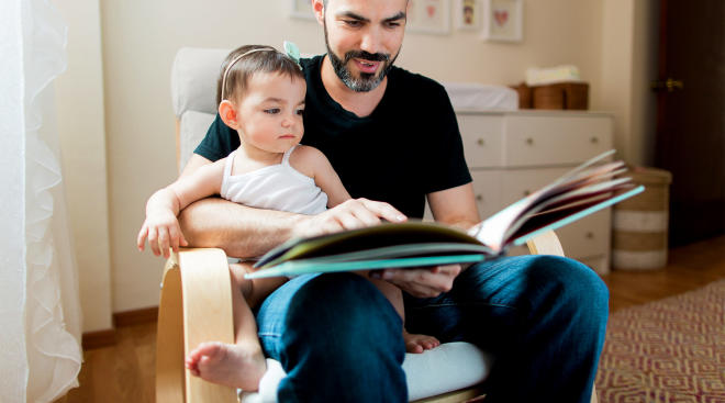dad reading to his baby girl