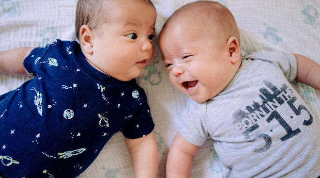 baby twins interacting with each other