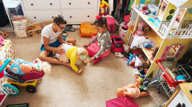 young children play in messy house