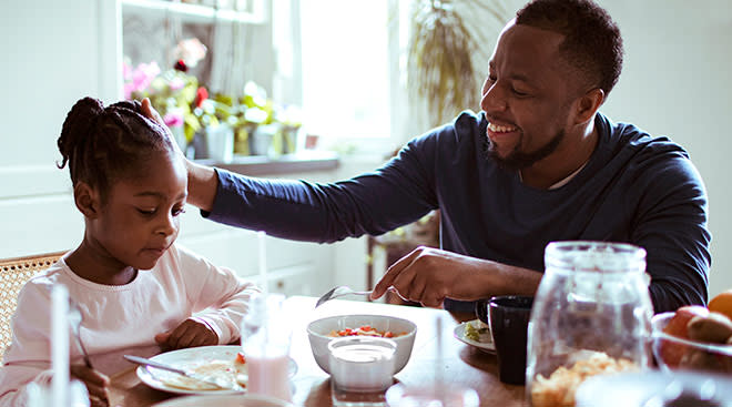 dad having meaningful conversation with his daughter in the kitchen during breakfast