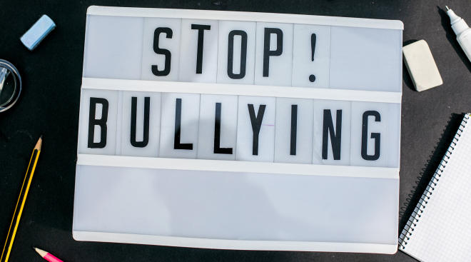 letterboard backlit sign that says stop bullying