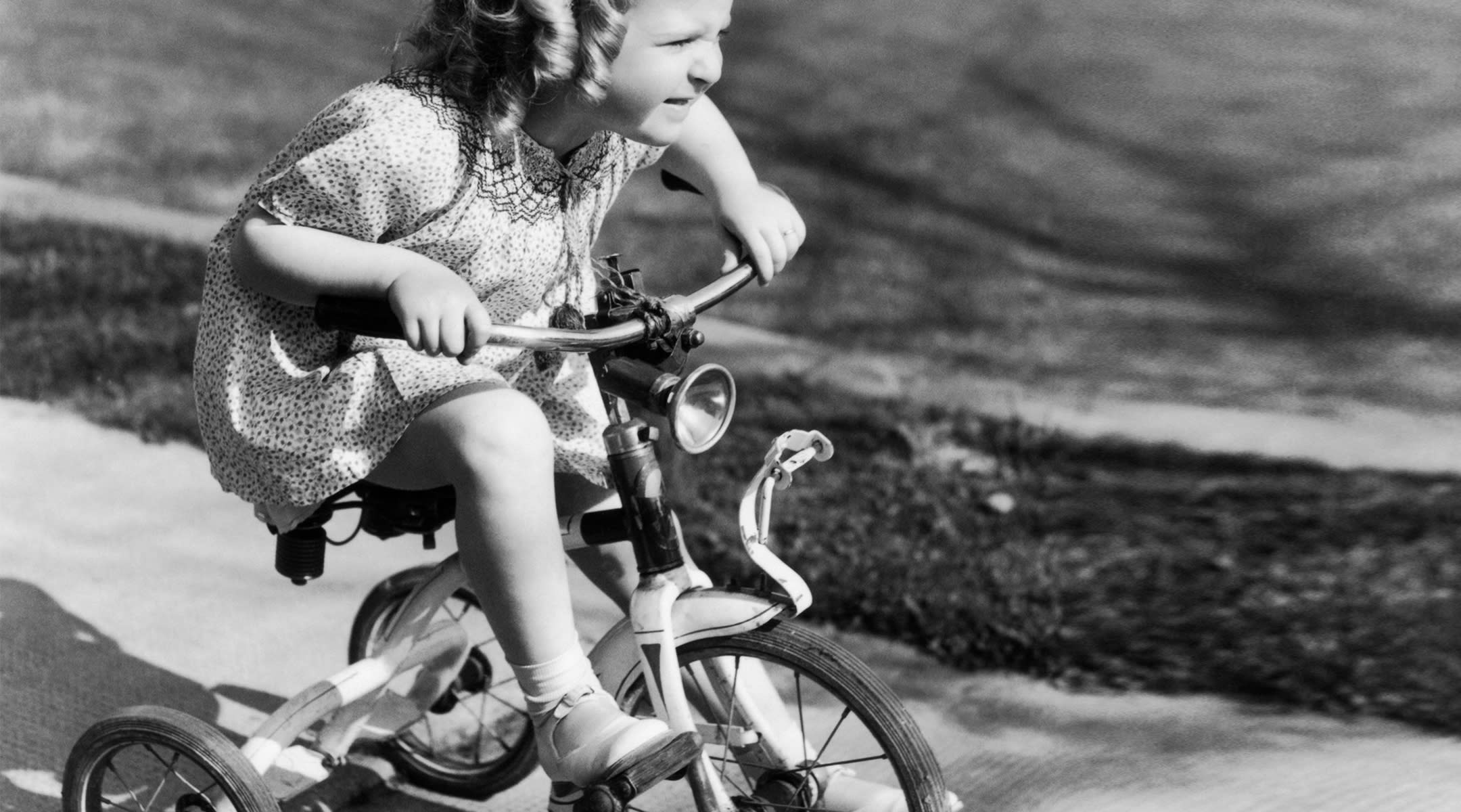 little girl with grit riding her bike