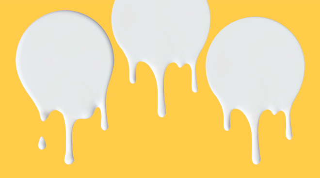 drops of milk on yellow background