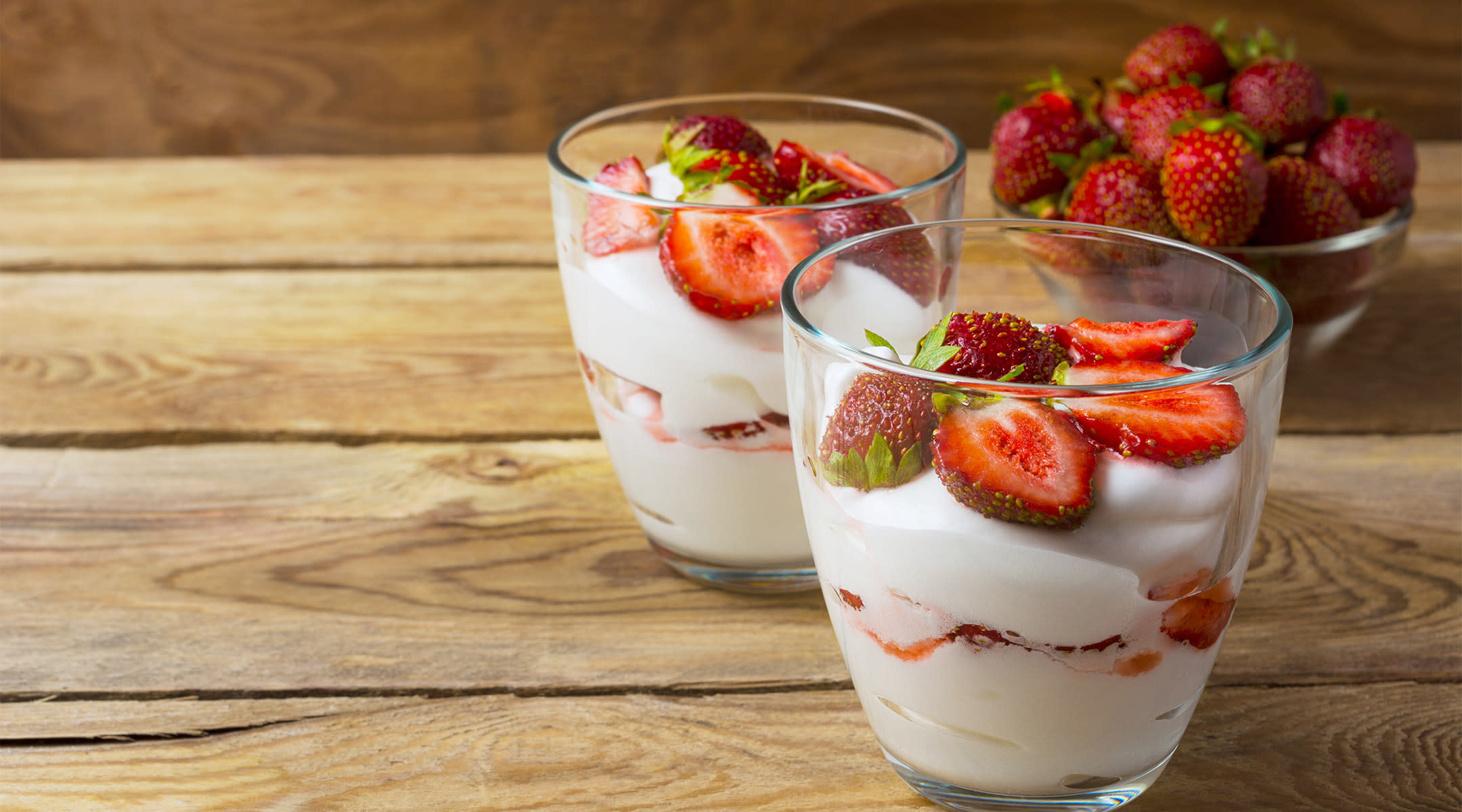 Healthy snack for pregnant women, yogurt and strawberries