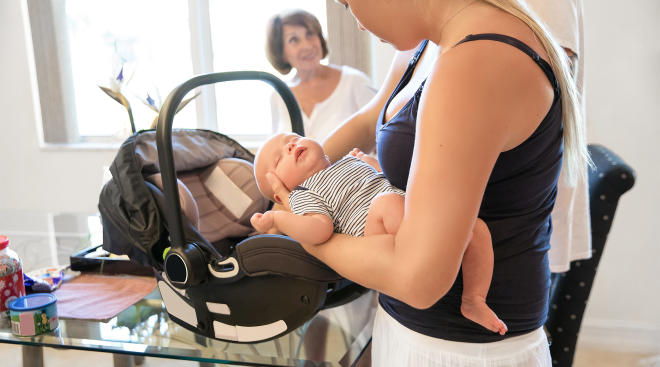 baby in car seat inside on a table