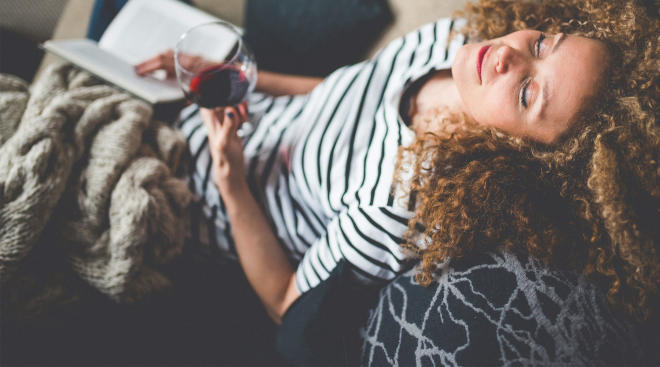 mom drinks red wine on the couch