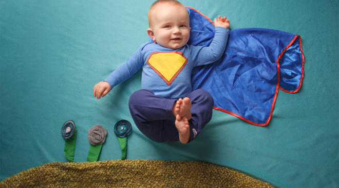 baby dressed up as super hero with blue cape