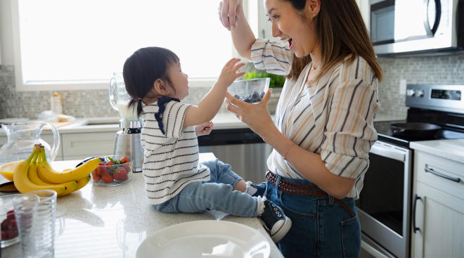 mom making a recipe in her kitchen with her toddler girl