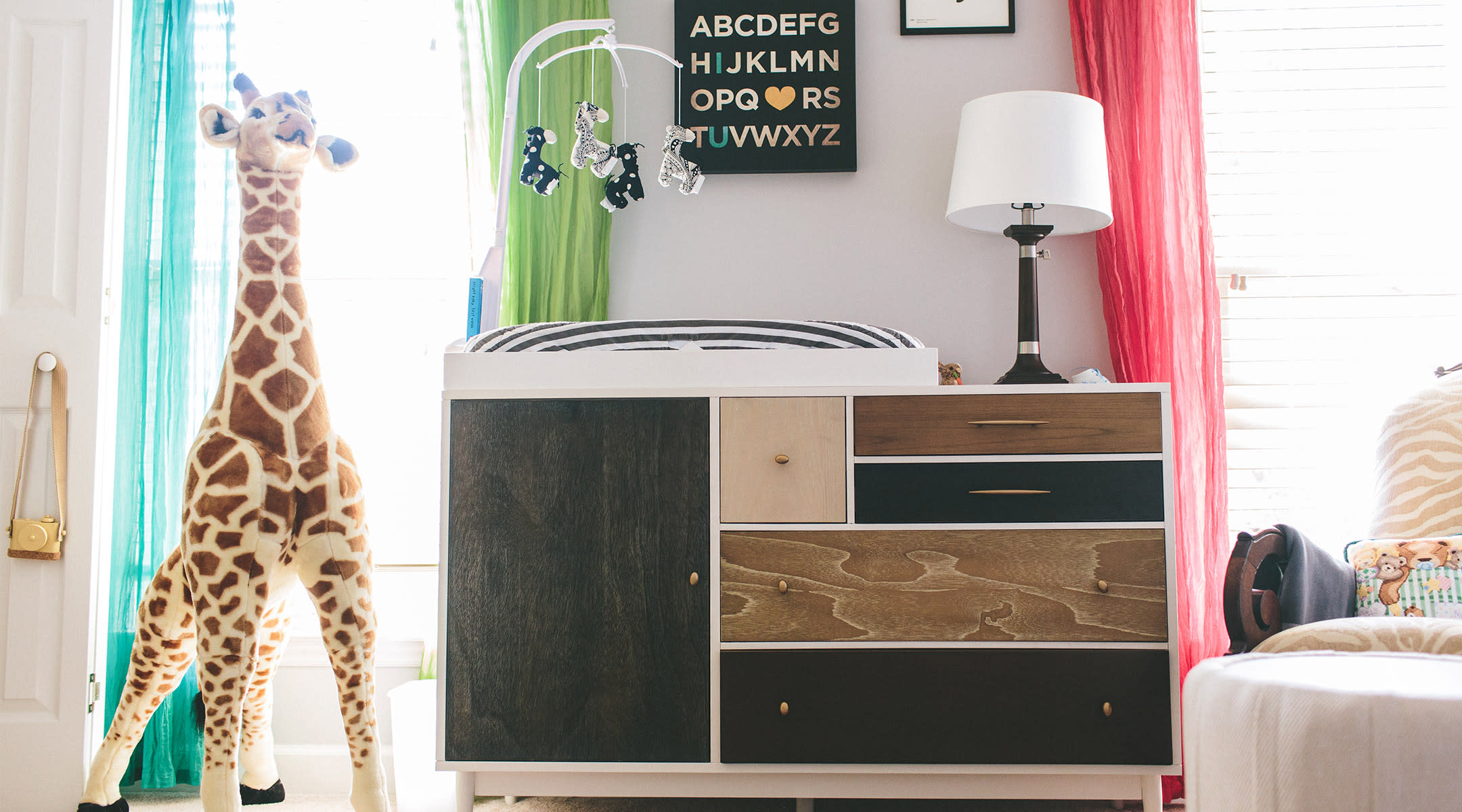 changing table in decorated nursery room