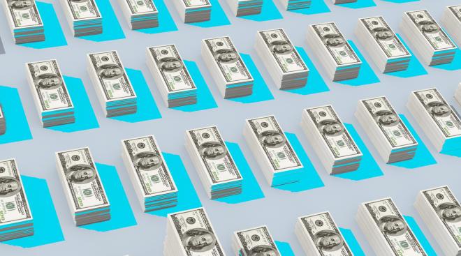 stacks of money hundred dollar bills