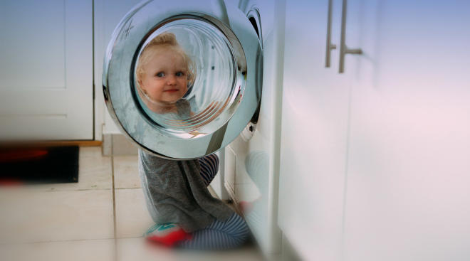 small child became trapped in washing machine