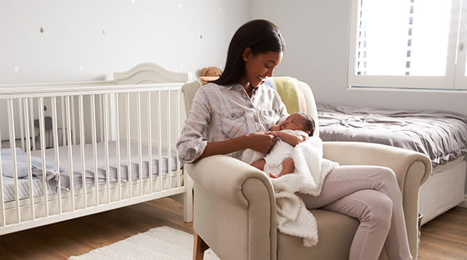 Mom and baby in a stylish home nursery