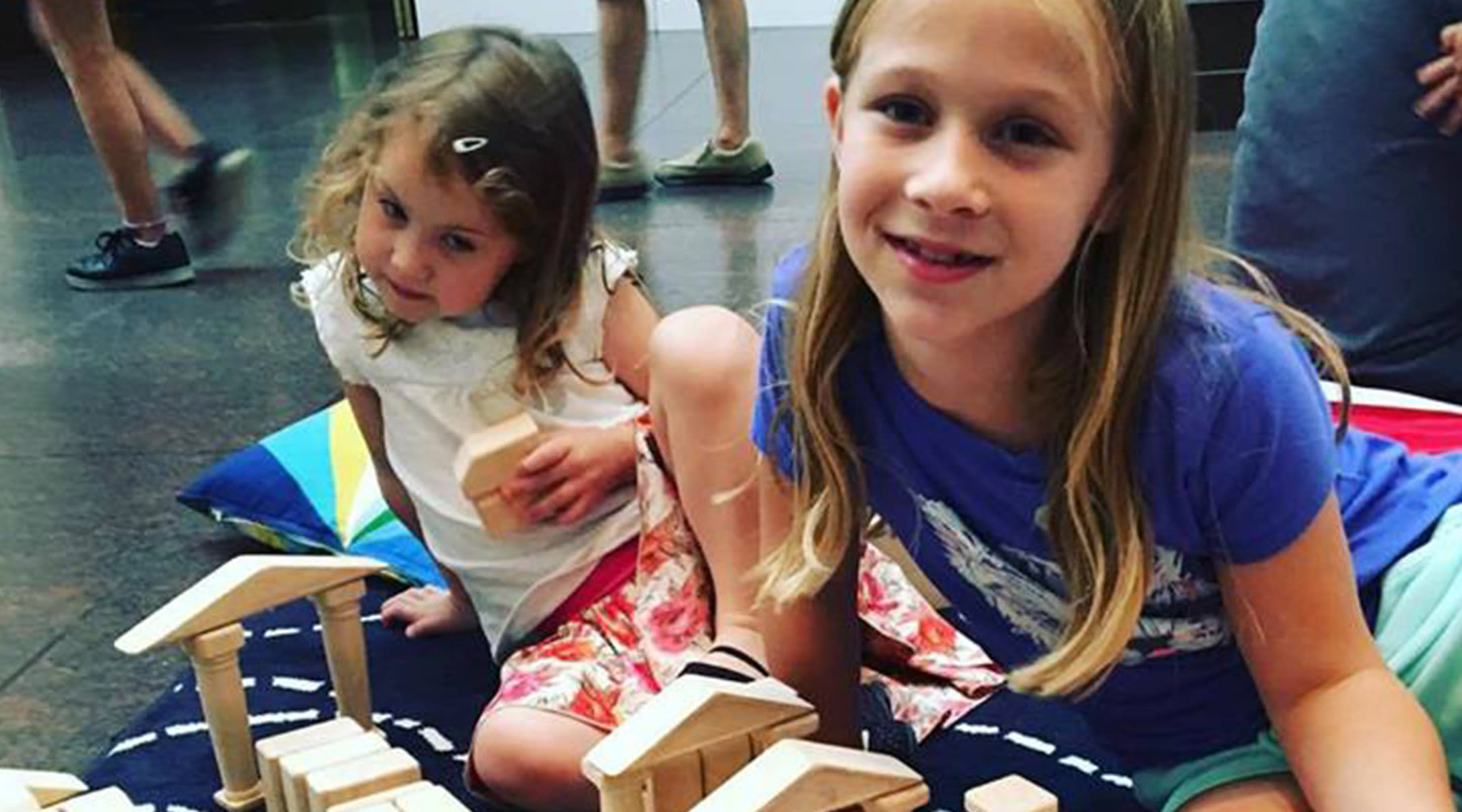 Two girls playing with blocks at a museum