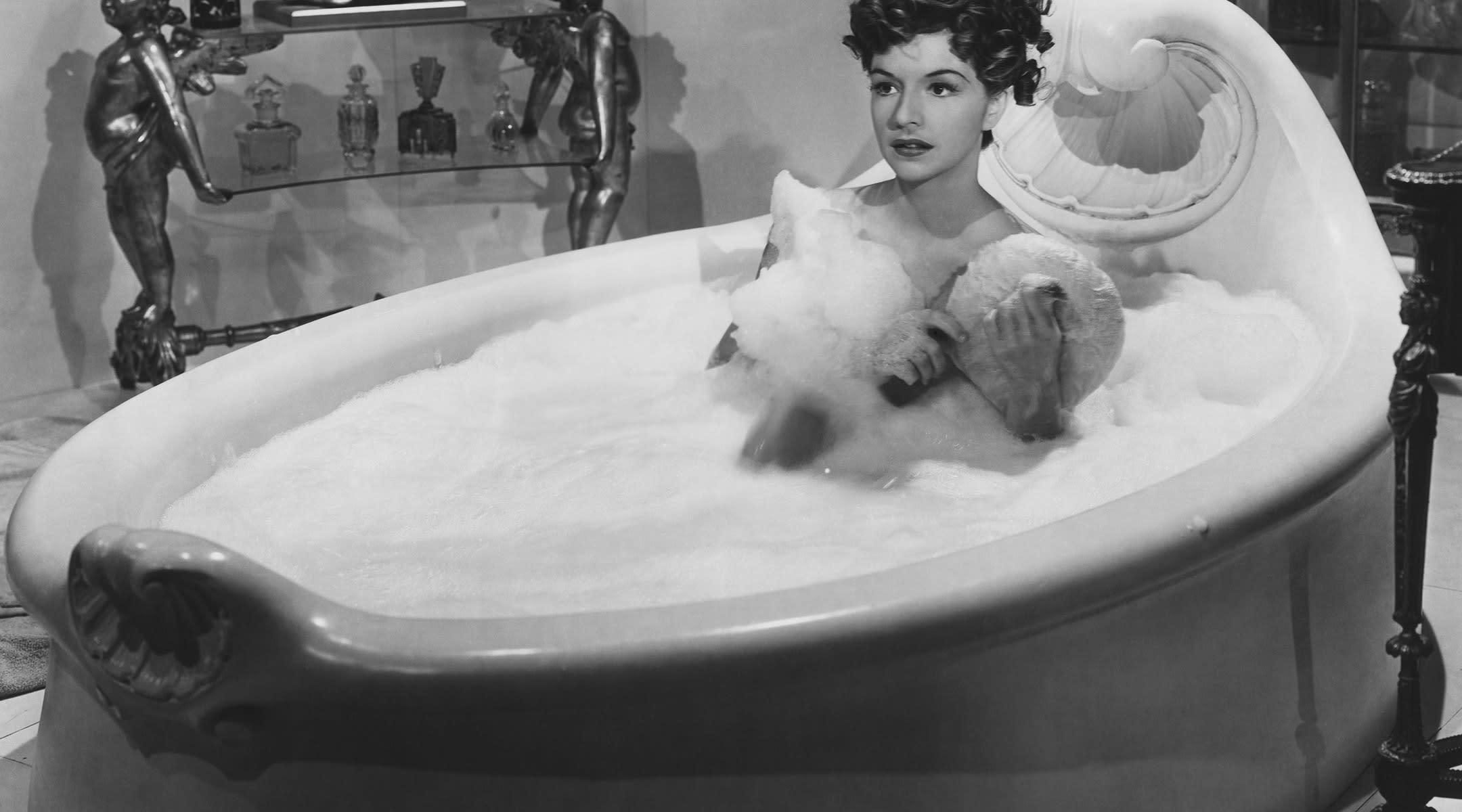 retro photo of woman in bubble bath