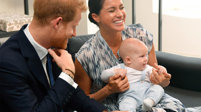 meghan markle and prince harry laughing with baby archie