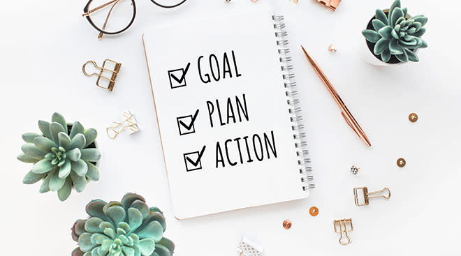 notebook that says goal, plan, action with check marks