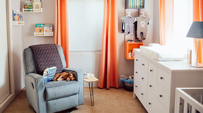 baby nursery with orange color accents