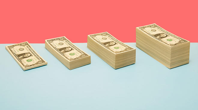 stacks of dollar bills in a row against colorful background
