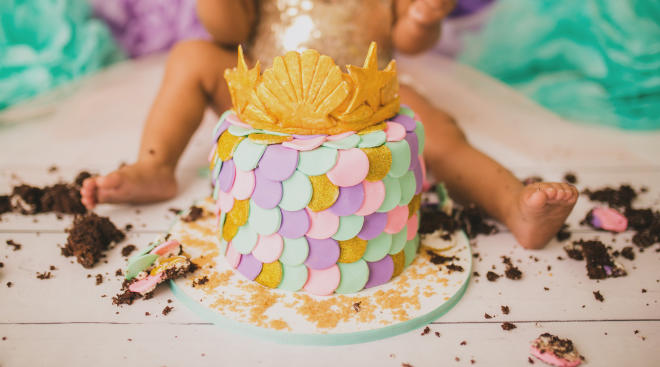 baby at cake smash photography session for first birthday