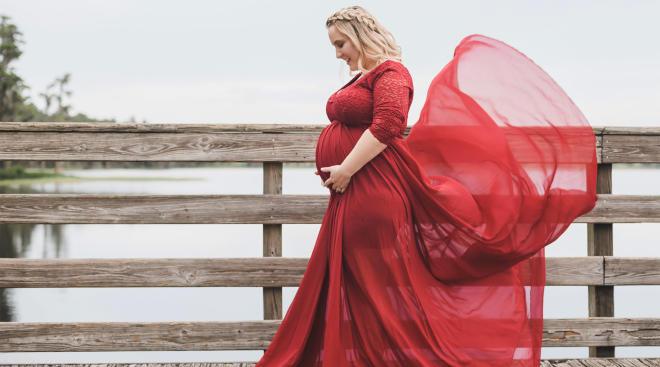 pregnant woman wearing beautiful flowy red dress