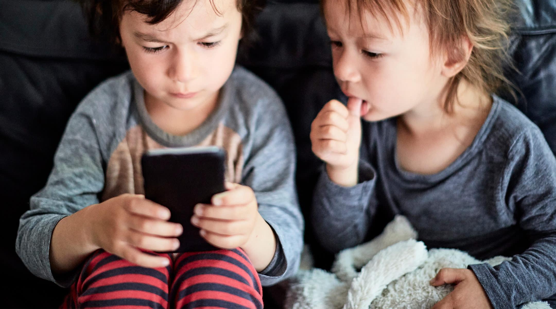 two little boy watching phone screen