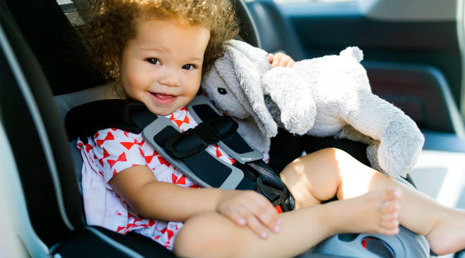 toddler traveling with toy in car