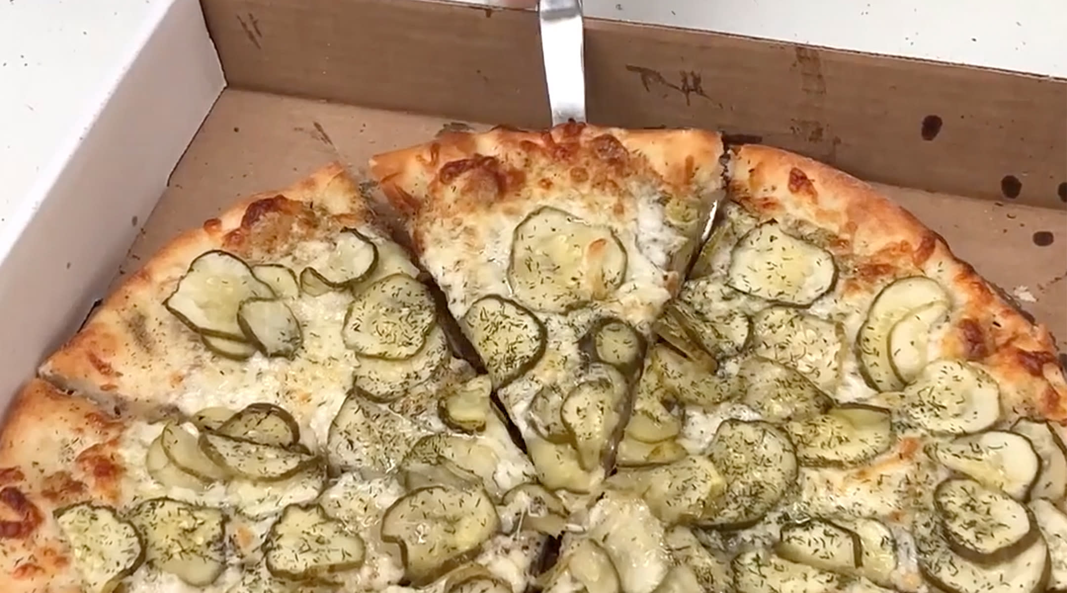 pizza covered in pickle toppings perfect for pregnancy cravings