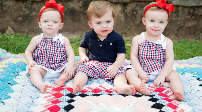 triplets outside wearing their 4th of july outfits