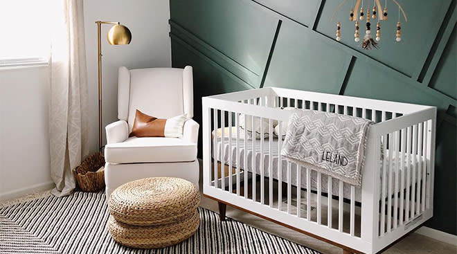 upscale baby boy nursery with green accent wall