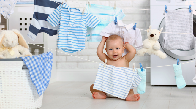 baby with laundry and clothesline