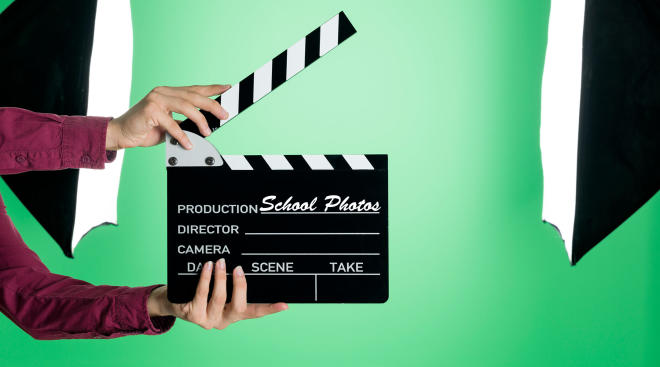 green screen set up for taking photos with clapperboard in foreground
