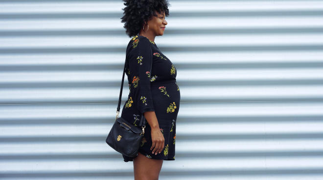 smiling pregnant woman in urban setting