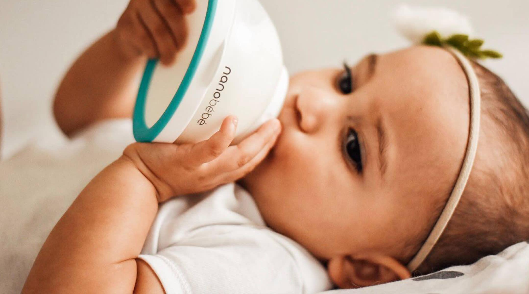 baby drinking from Nanobebe bottle
