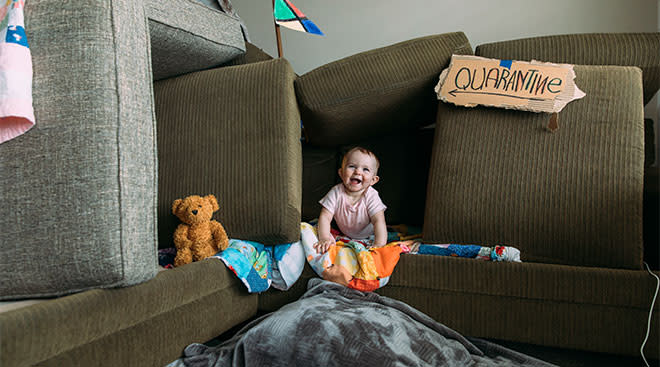 baby in couch fort during quarantine