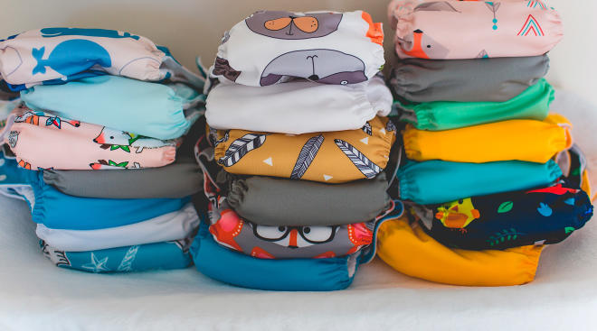 stacked cloth baby diapers with patterns