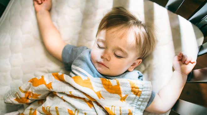 baby sleeping in his crib