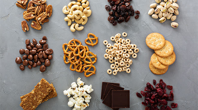 snacks such as nuts, arranged in small piles on surface