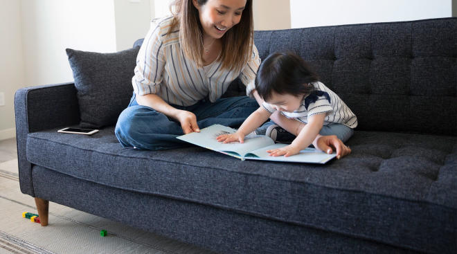mom reading with her toddler indoors