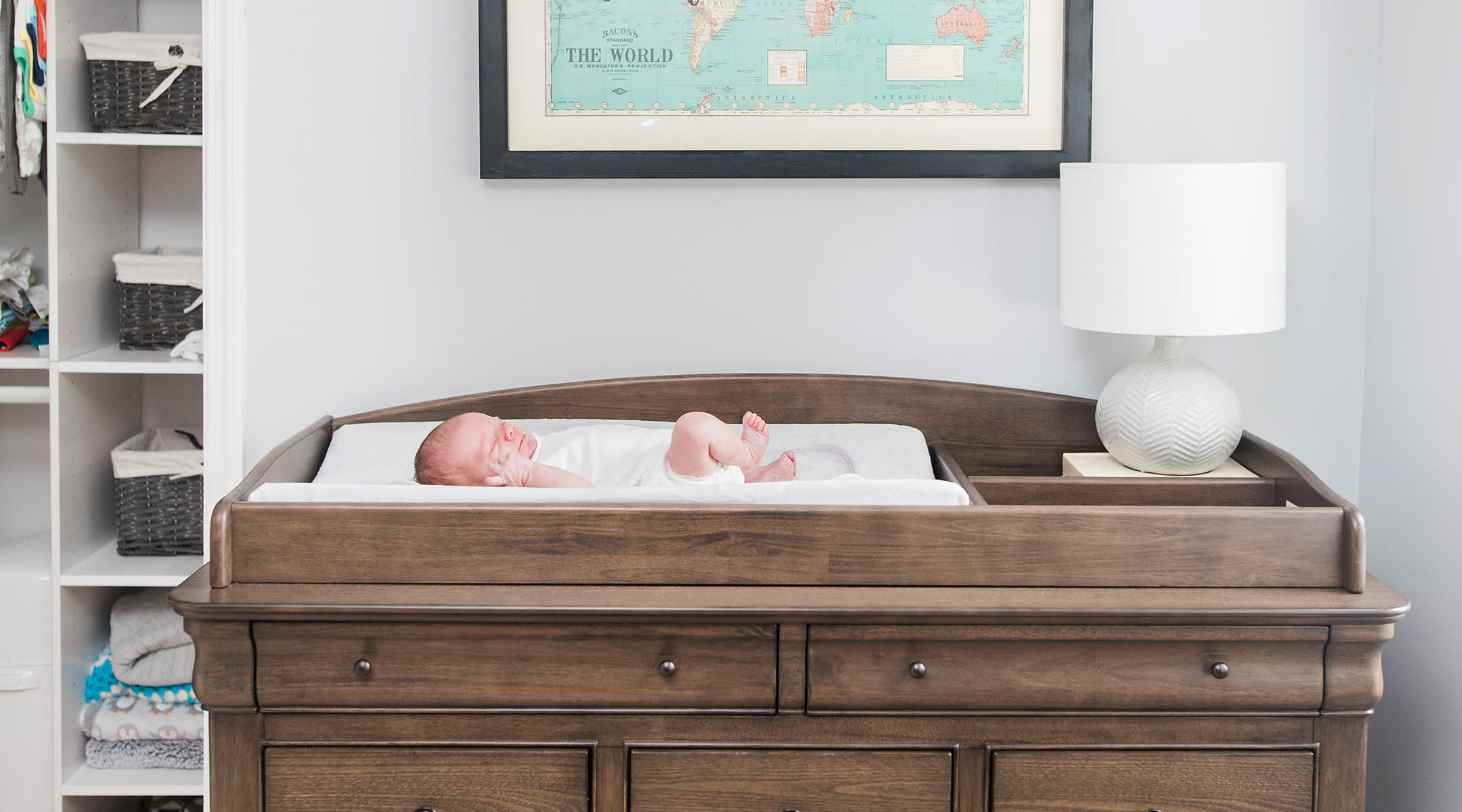 newborn baby on changing table